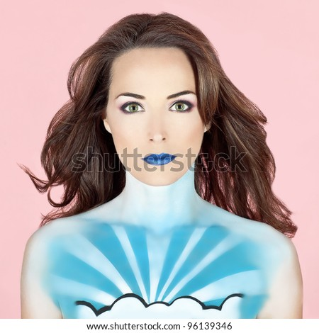 Closeup portrait of a beautiful woman with body painted to look like the sky - stock photo