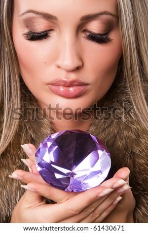 Closeup portrait of a beautiful woman with precious jewel - stock photo