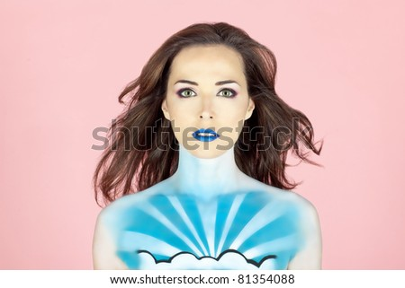 Closeup portrait of a beautiful woman with sky painted on her body isolated on pink background