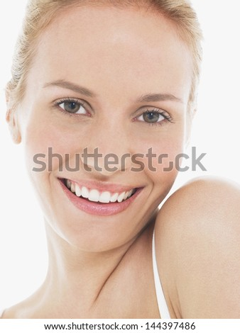 Closeup portrait of a beautiful young blond woman with clean face - stock photo
