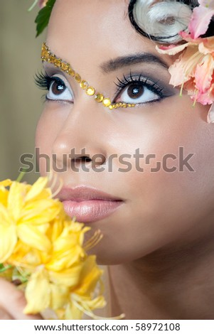 Closeup portrait of a beautiful young bride with curly hairstyle and fantasy makeup - stock photo