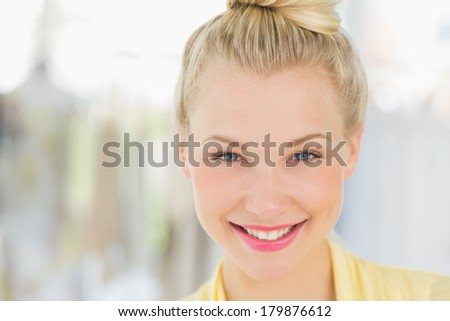 Closeup portrait of a beautiful young woman against blurred background - stock photo