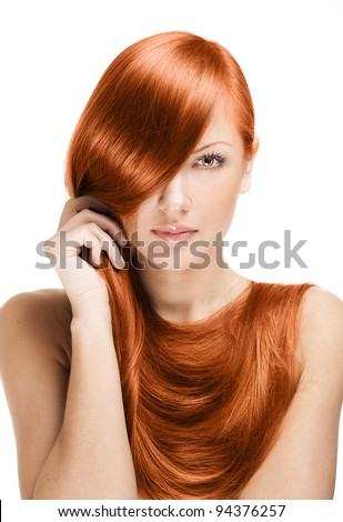 closeup portrait of a beautiful young woman holding her elegant long red shiny hair , hairstyle , healthy straight  hair ,  isolated on white background - stock photo