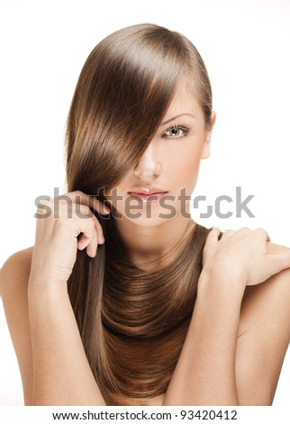 closeup portrait of a beautiful young woman holding her elegant long shiny hair , hairstyle , isolated on white background - stock photo