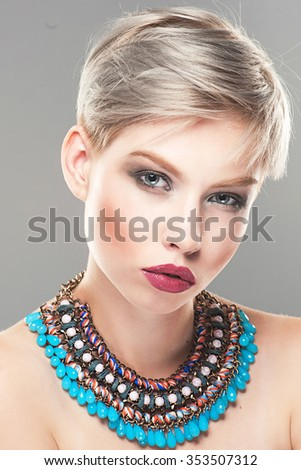 Closeup portrait of a beautiful young woman. Model with short platinum blond hair and makeup - stock photo