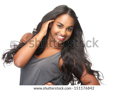 Closeup portrait of a beautiful young woman with hand in hair isolated on white - stock photo