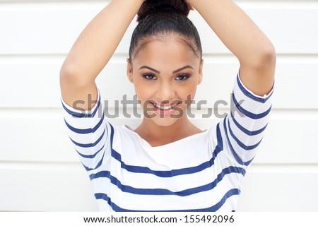 Closeup portrait of a beautiful young women smiling  - stock photo