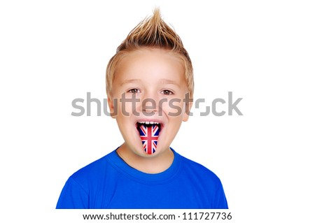 Closeup portrait of a boy showing tongue with british flag on it