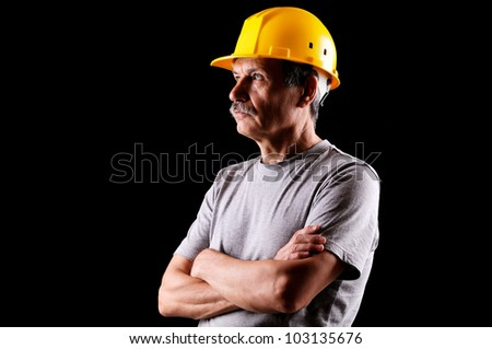 Closeup portrait of a constructor on a black background
