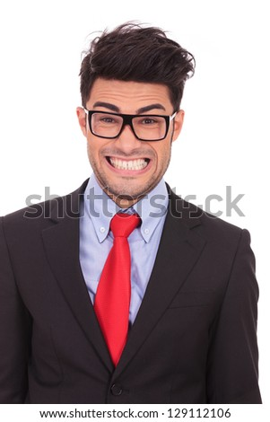 closeup portrait of a crazy business man showing his teeth with a large crooked smile - stock photo