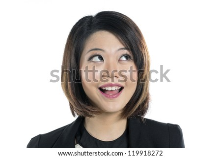 Closeup portrait of a Cute Chinese woman looking up into the corner. Isolated on white background.
