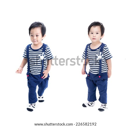 Closeup portrait of a cute little asian child on white background .