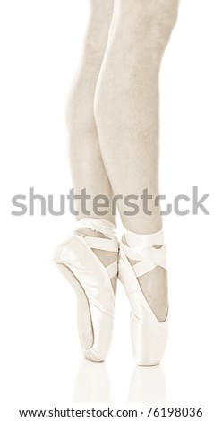 Closeup portrait of a dancer in ballet shoes dancing in Pointe - stock photo