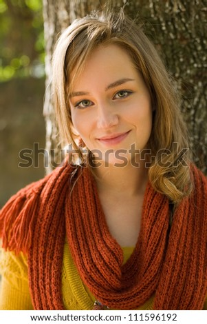 Closeup portrait of a fashionable young blond outdoors in the park on sunny autumn day. - stock photo