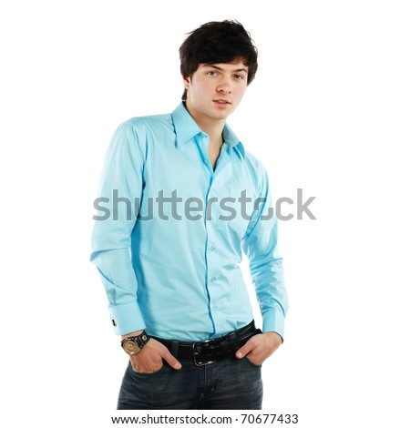 Closeup portrait of a handsome young sexual man smiling against white background - stock photo