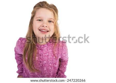 Closeup portrait of a happy cute little girl against white background - stock photo