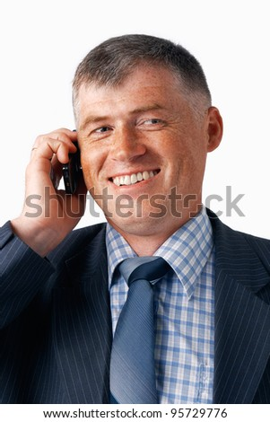 Closeup portrait of a happy elder businessman speaking on the mobile. - stock photo