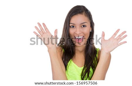 Closeup portrait of a Happy excited girl. Young beautiful woman smiling surprised holding, amazed  isolated on white background. Funky young joyful multicultural  female model. Positive human emotions - stock photo