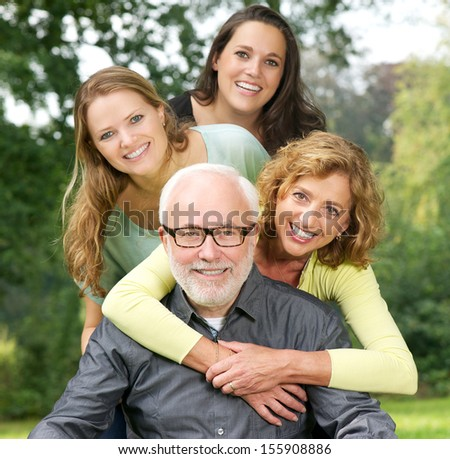 Closeup portrait of a happy family enjoying time together outdoors - stock photo