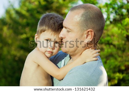 Closeup portrait of a happy father and son
