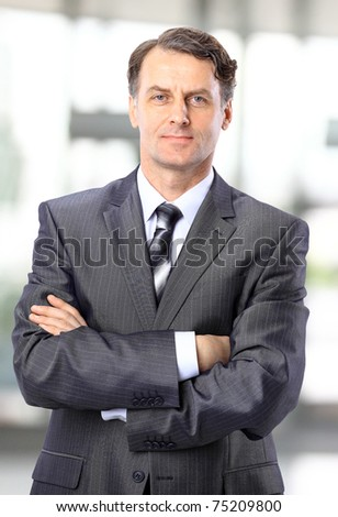 Closeup portrait of a happy mature business man smiling - Copyspace - stock photo