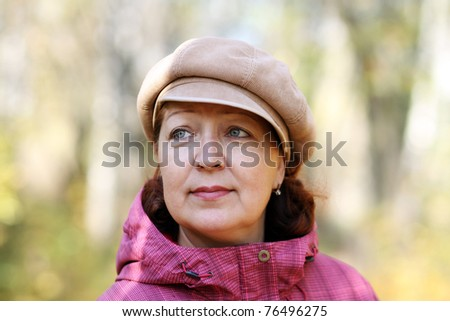 Closeup portrait of a happy mature woman - stock photo