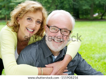 Closeup portrait of a happy older couple smiling  and showing affection - stock photo