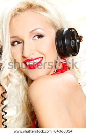 closeup portrait of a happy sexy woman posing in headphones over white - stock photo