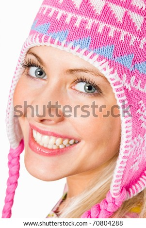 Closeup portrait of a happy young girl wearing woolen cap - stock photo