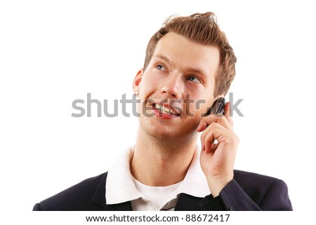Closeup portrait of a happy young guy speaking on cellphone isolated on white background