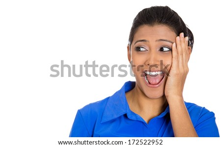 Closeup portrait of a happy young pretty woman looking to left shocked and surprised in full disbelief hand on cheek, isolated on white background. Positive human emotion facial expression feeling - stock photo