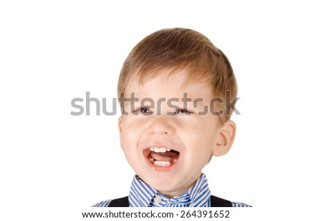 Closeup portrait of a laughing little boy isolated on white background - stock photo