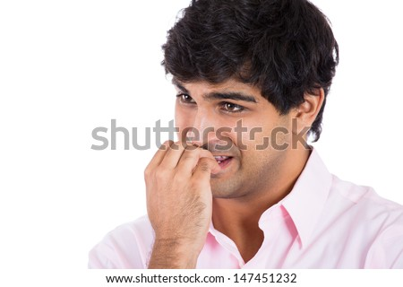 Closeup portrait of a man biting his nails stressed ands anxious, isolated on white background with copy space - stock photo