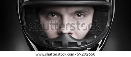 Closeup portrait of a man in helmet - stock photo