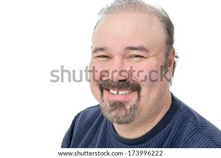 Closeup portrait of a middle-aged man with a goatee enjoying a good laugh smiling happily at the camera isolated on white with copyspace - stock photo
