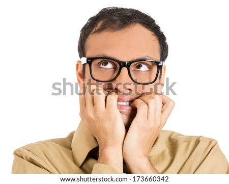 Closeup portrait of a nerdy guy, anxious man with big glasses, biting his finger nails craving something scared, looking up isolated on white background. Negative human emotions, facial expressions - stock photo