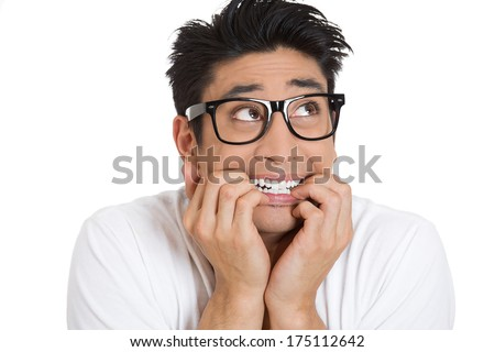Closeup portrait of a nerdy guy, anxious man with big glasses, biting his finger nails craving something scared, looking side isolated on white background. Negative human emotions, facial expressions - stock photo