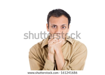 Closeup portrait of a nerdy guy with biting his finger nails with a craving for something or anxious, isolated on white background with copy space. Negative human emotion facial expressions