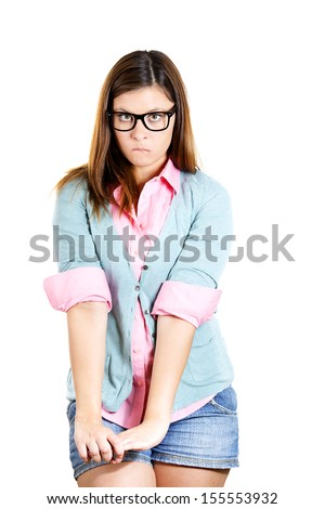 Closeup portrait of a nerdy insecure young girl with glasses, nervous looking to the side with a craving for something or anxious, isolated on white background. Human emotions, facial expressions. - stock photo