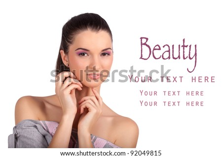 Closeup portrait of a pretty young woman touching her face and looking at the camera. High resolution image taken in studio. Isolated on pure white background with copy space for your ad.