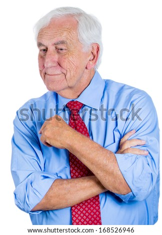Closeup portrait of a senior, elderly mature man daydreaming about something that makes him happy, looking down and to the side, life memories of the past, isolated on white background  - stock photo