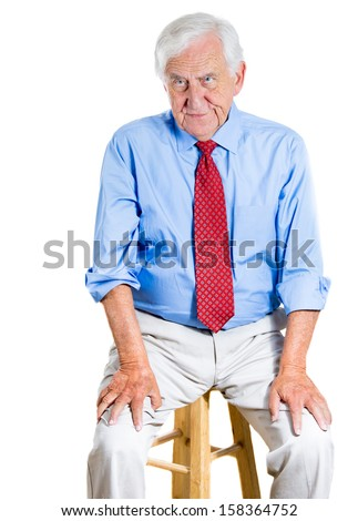 Closeup portrait of a senior executive, elderly man, grandpa with a very skeptical attitude, questioning look, sitting on chair, isolated on white background. Human personalities, conflict resolution. - stock photo