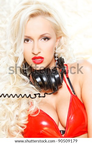 closeup portrait of a sexy beautiful woman posing in headphones over white