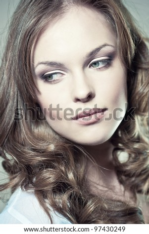 Closeup portrait of a sexy young woman with natural makeup and perfect skin - stock photo
