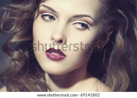 Closeup portrait of a sexy young woman with red lips - stock photo