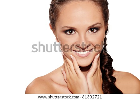 Closeup portrait of a smiling brunette girl on white background - stock photo