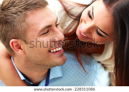 Closeup portrait of a smiling couple - stock photo