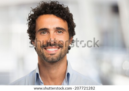 Closeup portrait of a smiling man - stock photo