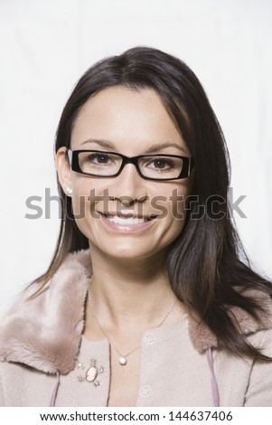 Closeup portrait of a smiling woman wearing glasses against white background