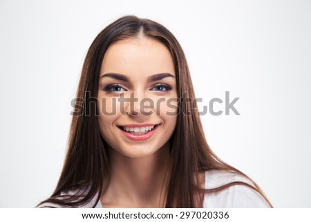 Closeup portrait of a smiling young girl looking at camera isolated on a white background - stock photo